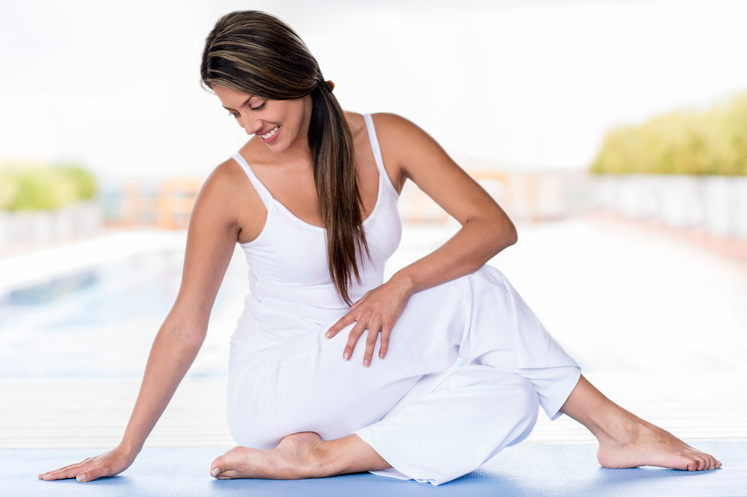 Beautiful woman relaxed in yoga pose