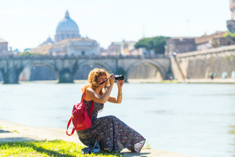 Young woman taking picture in Rome, Italy